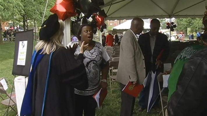 Mom Accepts Son's Diploma