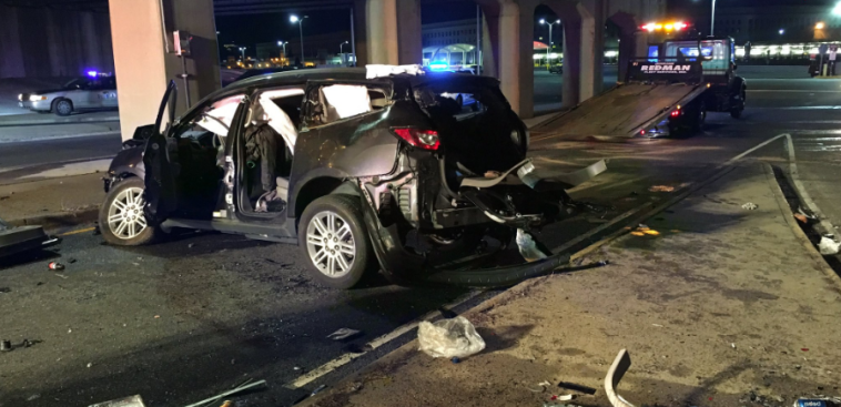 Car Goes Over I-395 Guardrail, Crashes Onto Street