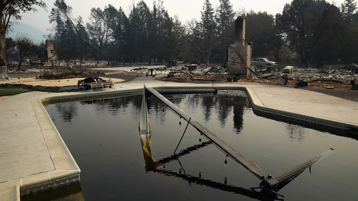 Couple Took Refuge in Pool as Wildfire Burned Home: Report